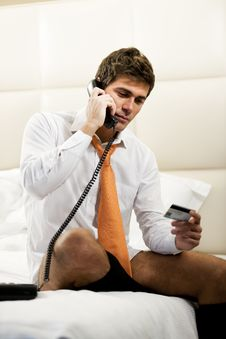 Free Relaxed Businessman Making Phone Reservation Stock Photography - 17269772