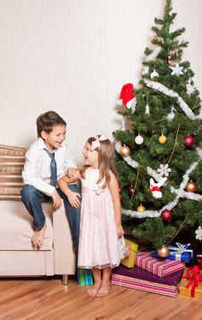 Free Girl And Boy Near A Fir-tree Royalty Free Stock Photo - 17269855