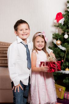Free Girl And Boy Near A Fir-tree Stock Image - 17269861