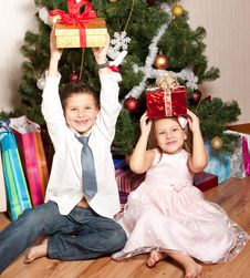 Free Girl And Boy Near A Fir-tree Royalty Free Stock Photos - 17269908