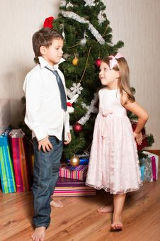 Free Girl And Boy Near A Fir-tree Royalty Free Stock Photo - 17269955