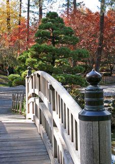Half View Of Footbridge In Japanese Garden Stock Photos