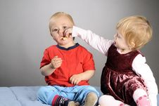 Free Girl Feeding Boy Stock Photography - 17274162