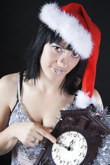 Girl In A Santa S Hat Holding The Clock Stock Photos