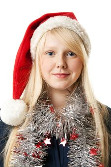 A Beautiful Young Blonde In A Santa Hat Royalty Free Stock Photography
