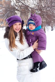 Free Mother Holding A Baby, Snow, Winter Park Royalty Free Stock Image - 17276306