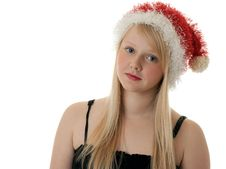 Beautiful Blonde Girl In A Santa Hat Royalty Free Stock Photo