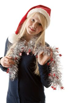 A Beautiful Young Blonde In A Santa Hat Royalty Free Stock Photo