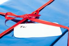 Closeup Of Gift With Greeting Card Stock Photo