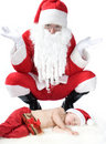 Free Santa Is Giving Gift To Sleeping Baby Royalty Free Stock Photo - 17283715