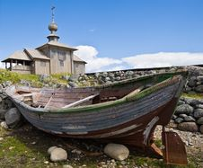 Wooden Chapel And Boat On Greater Zayatsky Island Royalty Free Stock Photo