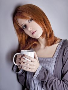 Free Portrait Of Red-haired Girl With Cup. Stock Images - 17281634
