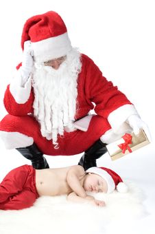 Free Santa Is Giving Gift To Sleeping Baby Royalty Free Stock Image - 17283706