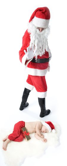 Free Santa Is Giving Gift To Sleeping Baby Stock Photography - 17283722
