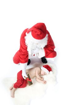 Free Santa Is Giving Gift To Sleeping Baby Royalty Free Stock Photography - 17283737