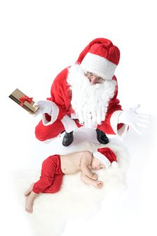 Free Santa Is Giving Gift To Sleeping Baby Stock Photography - 17283752