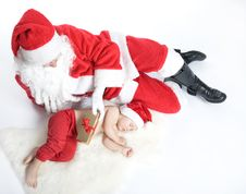 Free Santa Is Giving Gift To Sleeping Baby Stock Photography - 17283812