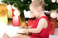 Free Baby Girl Under Christmas Tree Stock Photo - 17284160