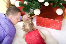 Free Little Baby Girl With Dad Under Christmas Tree Stock Photography - 17284452