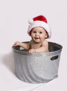 Free Smiling Baby Wearing Santa Hat Sitting In Wash Bas Stock Photography - 17285782