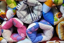 Pillows In Colorful Cloth Stock Photos