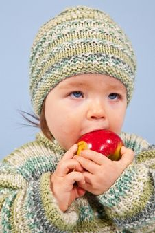 Free Young Boy Is Eating An Apple Stock Image - 17292431
