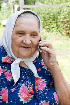 Grandmother Talking With A Phone Royalty Free Stock Photo
