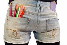 Colored Pencils In The Pocket Of Jeans Stock Photo