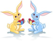 Free Two Rabbits And Gift. Royalty Free Stock Photos - 17296738