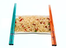 A Plate Of Rice And Chopsticks Isolated On White Stock Photography
