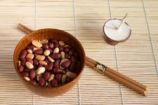 Free Bowl With Peanut And  Buddhistic Candle Stock Photos - 1731793