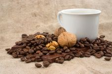 Free Cup Of Coffee, Walnuts, Coffee Beans And Chocolate Royalty Free Stock Images - 1736179