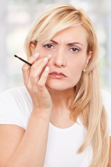 Free Beauty, Worriyng Woman Making-up Royalty Free Stock Image - 17301116