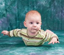 Free The Baby Lies On A Stomach. Royalty Free Stock Images - 17301669