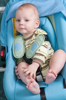 The Boy And A Seat Belt. Stock Photo