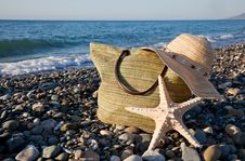 Free A Bonnet, A Bag And A Seastar Stock Image - 17304221