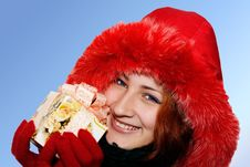 Free Portrait Of A Smiling Young Woman Giving A Gift Royalty Free Stock Photo - 17304475