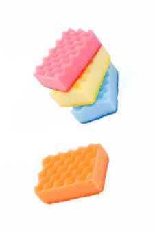 One And A Few Varicoloured Bath Sponges Stock Images