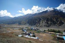 Free Nepali Small Village Under Snow Peaks Stock Photography - 17304562