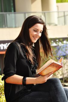 Free Young Beautiful Woman Reading A Book Stock Images - 17306344