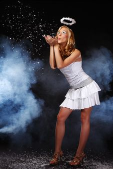 Free Cute Angel Girl Blow Snow In Heaven Royalty Free Stock Photos - 17307018