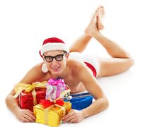 Free Christmas Man Laughs And Holds Gifts Stock Photo - 17308000