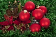 Christmas Red Balls On Green Decorated Background Royalty Free Stock Photos