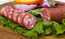 Slices Of Sausage On The Wooden Plate With K Royalty Free Stock Photos