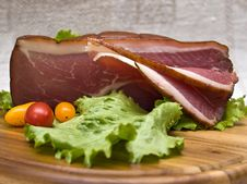 Slices Of Bacon On The Wooden Plate With Kni Royalty Free Stock Photo