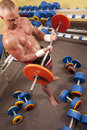 Free Muscular Man With A Bar Weights In Hands Training Royalty Free Stock Photos - 17318678