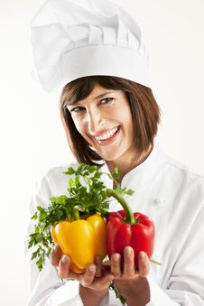 Female Chef With Vegetables Royalty Free Stock Photos