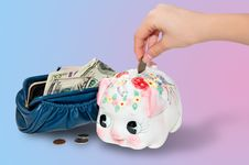 Free Putting Money Into The Piggy Bank Royalty Free Stock Images - 17310839