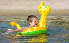 Child Swims In The River Royalty Free Stock Photos