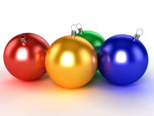 Free Four Christmas Balls Of Different Colors Royalty Free Stock Photography - 17311917